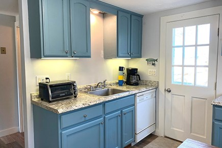 South Yarmouth Cape Cod vacation rental - Door to the back yard patio & grill
