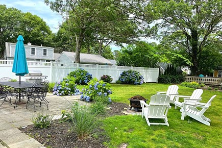 South Yarmouth Cape Cod vacation rental - Firepit in Back Yard