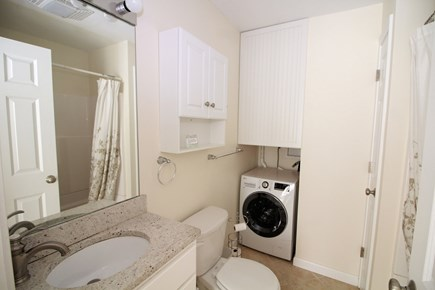 Truro Cape Cod vacation rental - Bathroom with tub/shower and washer/dryer combo unit.