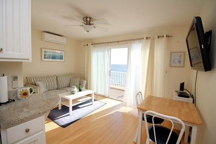 Truro Cape Cod vacation rental - Main living area is open and bright, slider to balcony