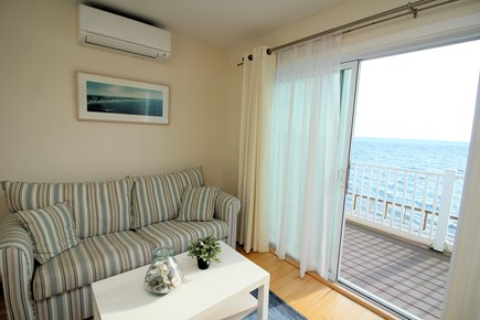 Truro Cape Cod vacation rental - Living room with slider to balcony and water views