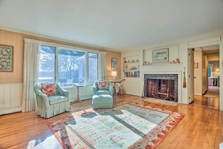 Orleans Cape Cod vacation rental - Fireplace/game room (hallway continues to bedrooms)