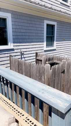 Dennis, Swan River Cape Cod vacation rental - Outdoor shower with changing space
