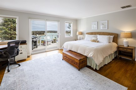 Orleans Cape Cod vacation rental - Main Level Master Bedroom with Deck Access and Water Views