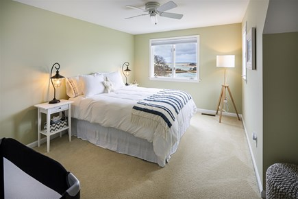 Orleans Cape Cod vacation rental - Upper lever bedroom with queen bed, crib and water views