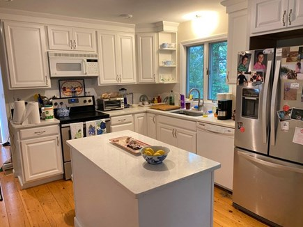 Chatham Cape Cod vacation rental - Kitchen looking out towards out door shower and lush backyard