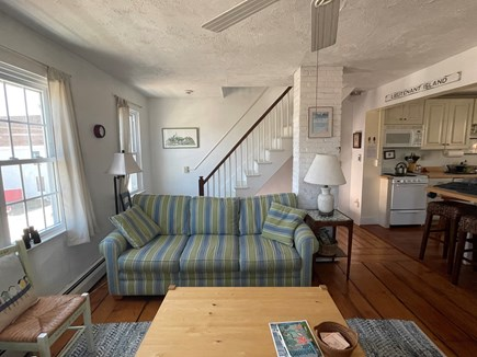 Wellfleet, The Bradford Cape Cod vacation rental - Living room and stairs going up to 3rd floor bedrooms