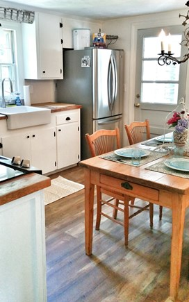 Yarmouth Port Cape Cod vacation rental - Kitchen with washer and dryer lead to an enclosed tiled breezeway