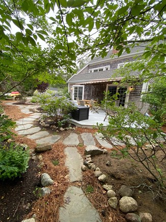 Eastham Cape Cod vacation rental - Exterior of pavers and path at the side of the house