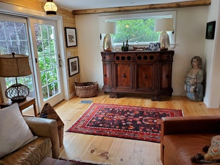 Eastham Cape Cod vacation rental - Living room with ancient credenza sourced from a Truro mansion