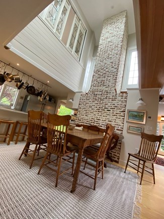 Eastham Cape Cod vacation rental - Kitchen looking up at the clerestory, aged brick backdrop