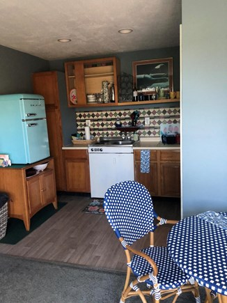 West Yarmouth Cape Cod vacation rental - Small yet efficient kitchen area, stovetop, gas grill on deck