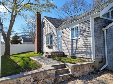 Hyannis Cape Cod vacation rental - Side view  Outdoor shower gas grill and patio