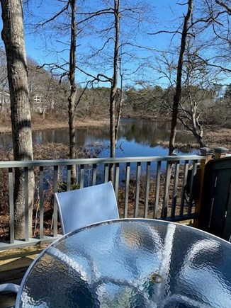 Mashpee Cape Cod vacation rental - Enjoy dinner on the back deck overlooking Dean's Pond.