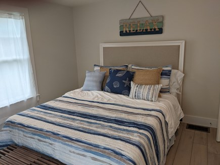 Dennis - Bayview Beach  Cape Cod vacation rental - Master bedroom with queen bed, ceiling fan, closet, dresser, tv