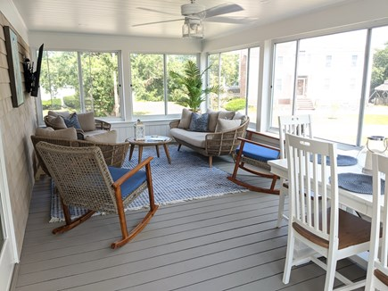 Dennis - Bayview Beach  Cape Cod vacation rental - Relaxing 3 season porch with smart tv and comfy seating for 7
