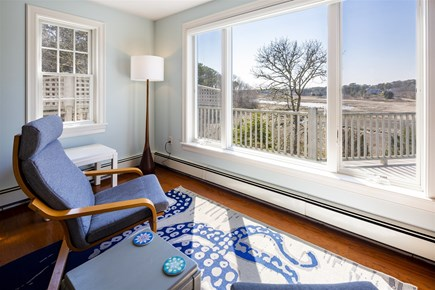 Chatham Cape Cod vacation rental - Sitting area looking out on back deck and marsh