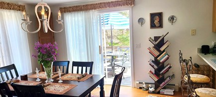 Truro Cape Cod vacation rental - Dining area includes the breakfast bar and colorful cookbooks