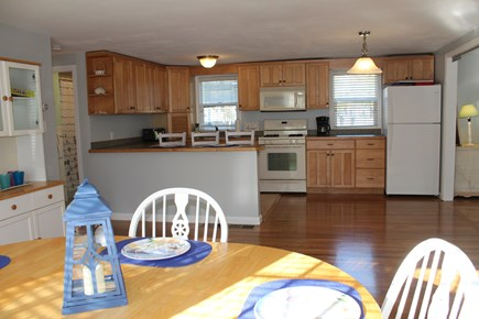 Yarmouth Cape Cod vacation rental - Kitchen table facing the kitchen area.
