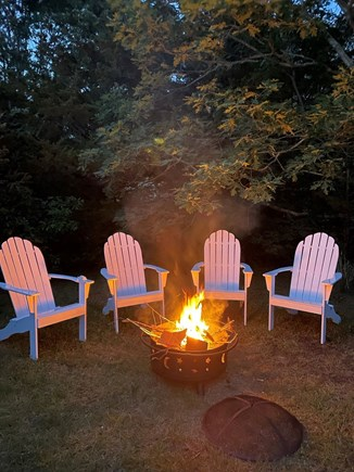 Eastham Cape Cod vacation rental - Firepit with 4 Adirondack Chairs.