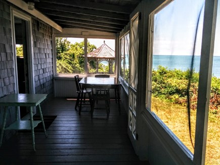 Brewster Cape Cod vacation rental - Eat in Porch w/rocking chair. Watch the tide roll in and out