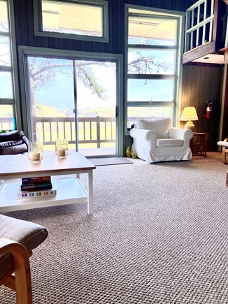 Chatham Cape Cod vacation rental - View from living room looking onto upper deck and stairs to loft.
