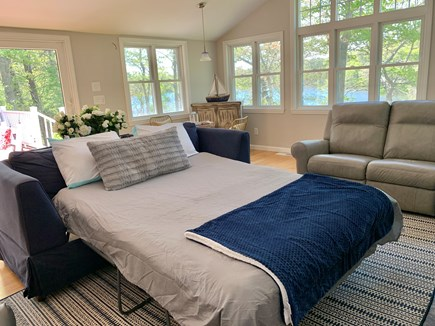 Barnstable, Hyannis Cape Cod vacation rental - Queen sofa bed in the family room with closed doors.