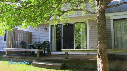 Mashpee Cape Cod vacation rental - The back deck with dining area