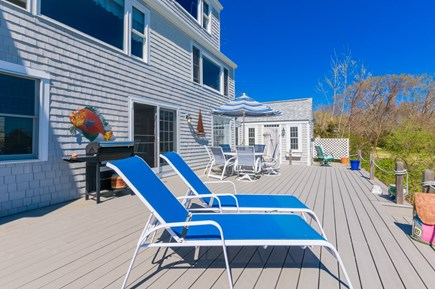 Sandwich Cape Cod vacation rental - Back deck with lounge seating and fabulous views`