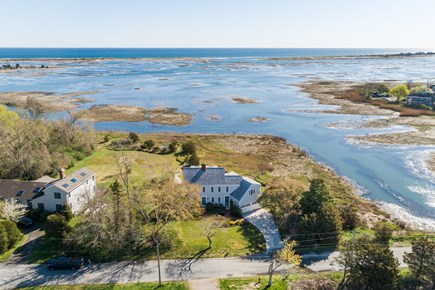 Sandwich Cape Cod vacation rental - Aerial of home looking over marsh, creek and out to sea