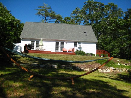 Brewster Cape Cod vacation rental - Backyard Deck View, gas grille, patio table umbrella, chairs