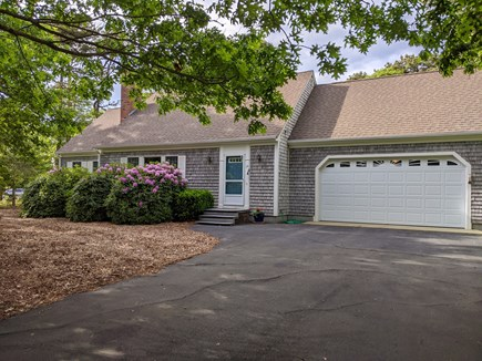 Eastham Cape Cod vacation rental - The house is on a quiet residential street, surrounded by trees.