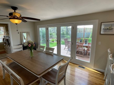Eastham Cape Cod vacation rental - Dining table w/ patio access (expands with an extra leaf)