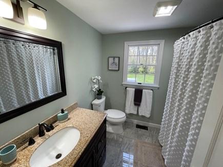 Eastham Cape Cod vacation rental - Downstairs bathroom w/ bathtub & shower