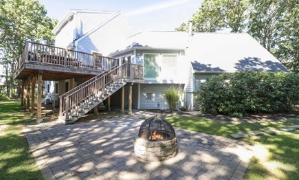 Mashpee, South Cape Beach Estates  Cape Cod vacation rental - Large back yard and fire pit.
