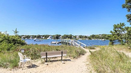 Mashpee, South Cape Beach Estates  Cape Cod vacation rental - Association beach is 100 yards away. Beautiful sunsets from dock.