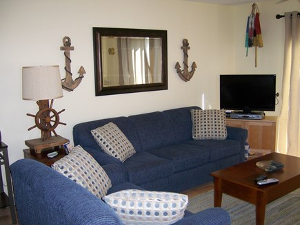 Provincetown Cape Cod vacation rental - Living room area with couch, chair, lift-top coffee table and TV