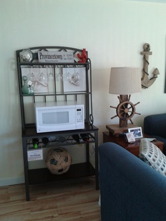Provincetown Cape Cod vacation rental - Kitchen rack with wine bottle storage, wine glasses & microwave