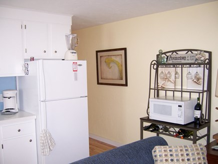 Provincetown Cape Cod vacation rental - Kitchen with view to hallway entrance to bedrooms and bathroom
