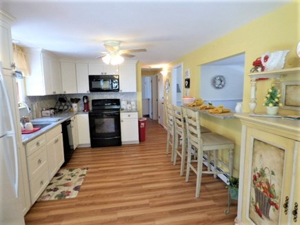 South Dennis Cape Cod vacation rental - Kitchen with pass through to Living room