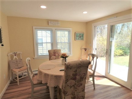 South Dennis Cape Cod vacation rental - East in kitchen with slider to back yard