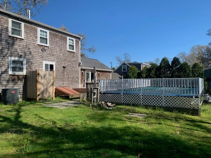 Chatham Cape Cod vacation rental - Full view of the fenced in backyard with pool, tub, and shower