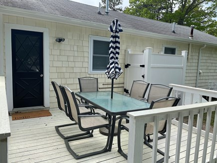 South Yarmouth Cape Cod vacation rental - Back deck patio set and outdoor shower.