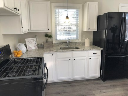 South Yarmouth Cape Cod vacation rental - Full kitchen with gas oven, stove top and Fridge.