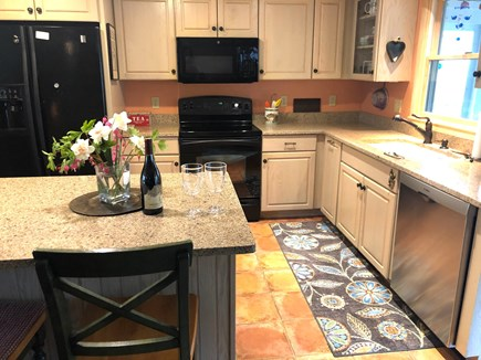 Harwich Cape Cod vacation rental - Kitchen with 3 seat island, opens to spacious screen porch