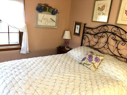 Harwich Cape Cod vacation rental - Master bedroom with comfortable queen bed and window AC