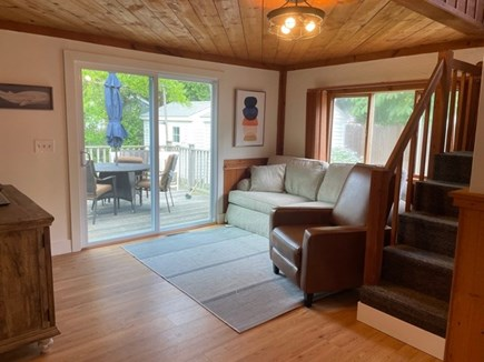 Falmouth, Maravista Neighborhood  Cape Cod vacation rental - Terrific den that leads to the back porch and backyard.