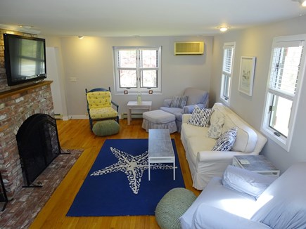 Chatham Cape Cod vacation rental - Comfortable living room with hardwood floors, fireplace, TV