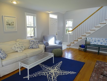 Chatham Cape Cod vacation rental - Living room showing staircase to two bedrooms and bath