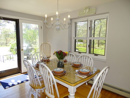 Chatham Cape Cod vacation rental - Dining area opens through slider to back deck with grill